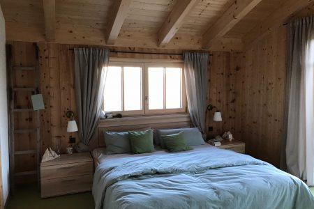 Massivholzhaus Schlafzimmer